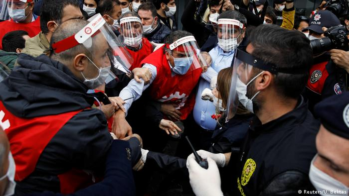 Trade union leaders clash with Turkish riot and plainclothes police officers as they attempt to defy a ban and march on Taksim Square