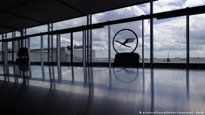 An empty airport lounge at Köln-Bonn airport in Germany, with the Lufthansa logo embossed on one of the windows. Archive image from April 30, 2020.