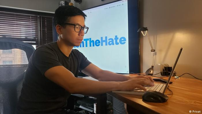 Telly Wong with a WashTheHate logo in the background
