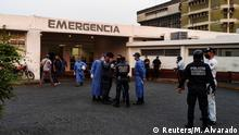 Healthcare workers and members of the Bolivarian national police wait for the arrival of prisoners outside a hospital after a riot erupted inside a prison in Guanare, Venezuela May 1, 2020. REUTERS/Manuel Alvarado NO RESALES. NO ARCHIVE.