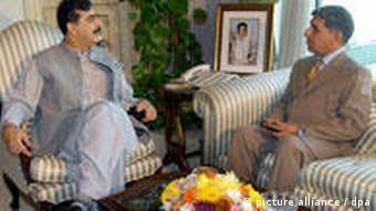 ISI director Shuja Pasha and Pakistan's prime minister