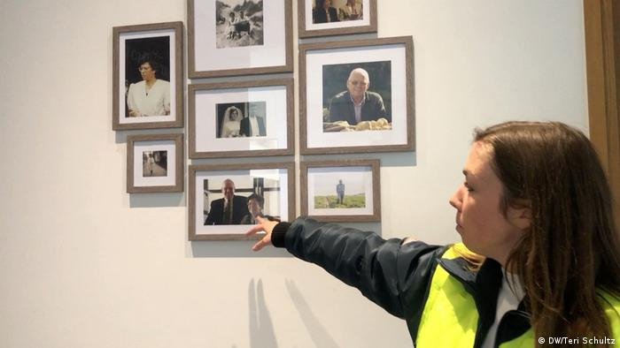Jolien Mylle, whose grandfather founded the Mydibel potato processing plant, shows family photos.