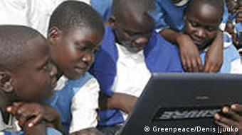 Kenyan students typing on a laptop computer