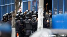 Riot police contain people, who were detained for violating El Salvador's nationwide lockdown measures, as they protest after government authorities did not release them despite having served their mandatory quarantine at a detention center, as the government undertakes steadily stricter measures to prevent the spread of the coronavirus disease (COVID-19), in San Salvador, El Salvador May 4, 2020. REUTERS/Jose Cabezas