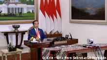President Joko Widodo NAM Virtual Summit 2: Indonesia President Joko Widodo listened to the speech from the participants of virtual summit Non-Alignment Movement (NAM), Monday (04/05). Foto: Kris - Biro Pers Sekretariat Presiden, in Bogor, West Java, Monday (04/05).