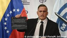 Venezuela's Attorney General Tarek William Saab holds up twitter posts during a press conference regarding what the government calls a failed attack over the weekend aimed at overthrowing President Nicolás Maduro in Caracas, Venezuela, Monday, May 4, 2020. The twitter posts are between two members of the opposition, Humberto Calderon and Yon Goicoechea. (AP Photo/Matias Delacroix) |