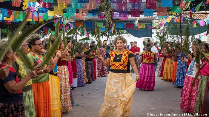 Indigenous Mexicans dressed in colorful traditional clothing celebrate an agricultural festival
