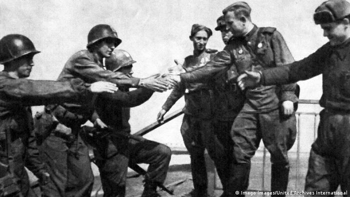Soviet and American troops meet at the River Elbe, near Torgau in Germany