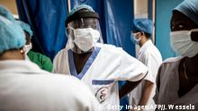 A Doctor wears a protective mask inside the emergency ward in Pikine Hospital in Dakar on April 23, 2020. - As COVID-19 coronavirus cases slowly increase in Senegal, hospitals are preparing to receive and test suspect cases whilst safely treating their normal patients. (Photo by JOHN WESSELS / AFP) (Photo by JOHN WESSELS/AFP via Getty Images)