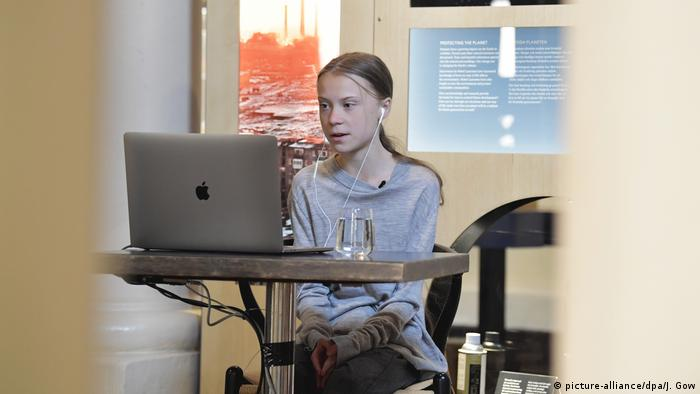 Greta Thunberg sits on her laptop in the Stockholm Nobel Museum on Earth Day 2020