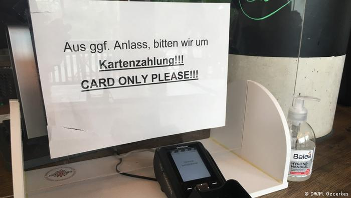 A sign at a Berlin cafe asking customers to pay with a card and not cash