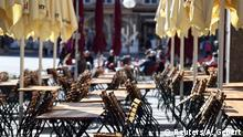 empty chairs and tables are seen in front of a restaurant during the spread of the coronavirus disease in Munich