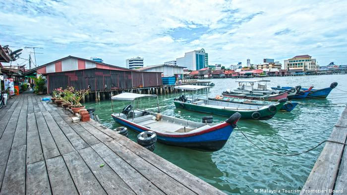 The small boats on the Malaysian island Penang are waiting for visitors