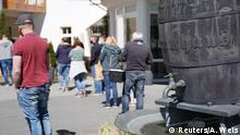 People queue in front of the Willinger Brauhaus to get beer as a gift, which could not be sold due to the lack of guests, amid the spread of the coronavirus disease (COVID-19), in Willingen, Germany, May 7, 2020. REUTERS/Annkathrin Weis