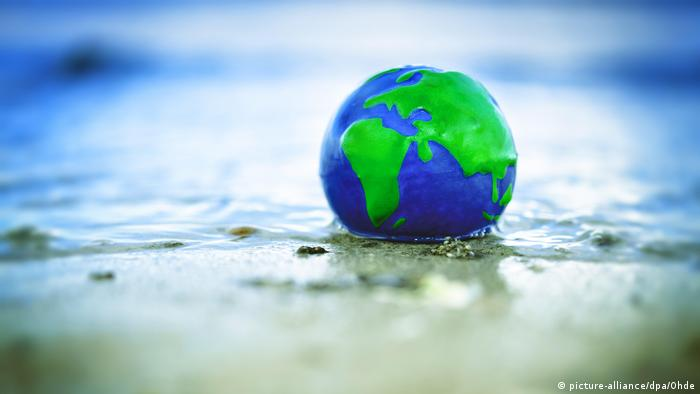 A globe in a puddle of water