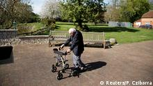 Retired British Army Captain Tom Moore, 99, raises money for health workers by attempting to walk the length of his garden one hundred times before his 100th birthday this month as the spread of coronavirus disease (COVID-19) continues, Marston Moretaine, Britain, April 15, 2020. REUTERS/Peter Cziborra TPX IMAGES OF THE DAY