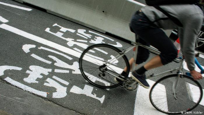 A cyclist in a bike lane