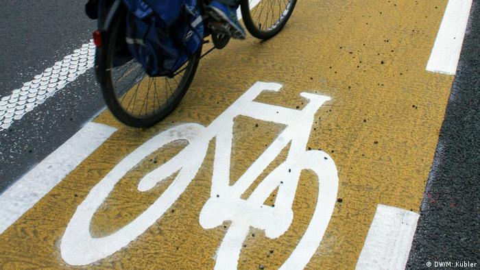 A bicycle riding in a yellow bike lane