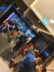 People stand closely together as they wait in a line on TUI's My Schiff 3