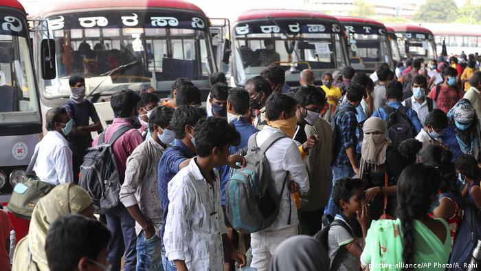 People crowding at a bus stop in Bangalore