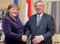 Germany's Chancellor Angela Merkel, left, smiles as she's shakes hands with Luxembourg's Prime Minister Jean Claude Juncker in his office at the State Ministry in Luxembourg, Tuesday March 9, 2009. Merkel is on a one-day working visit in Luxembourg. (AP Photo/Nicolas Bouvy, Pool)