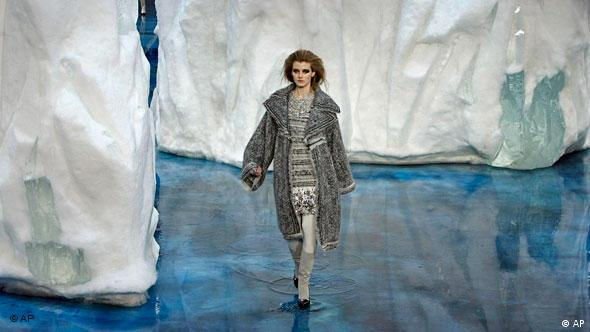A model presents creations by German designer Karl Lagerfeld as part of his fall/winter ready-to-wear Chanel fashion collection 2010, at the 2010 Paris Fashion Week