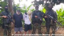 PUERTO CRUZ, VENEZUELA - MAY 8: (----EDITORIAL USE ONLY 'Äì MANDATORY CREDIT - DEFENSE MINISTRY OF VENEZUELA/ HANDOUT - NO MARKETING NO ADVERTISING CAMPAIGNS - DISTRIBUTED AS A SERVICE TO CLIENTS----) A photo shows 2 mercenaries caught by Venezuelan soldiers on charges of coup in Puerto Cruz, Venezuela on May 8, 2020. DEFENSE MINISTRY OF VENEZUELA / Anadolu Agency | Keine Weitergabe an Wiederverkäufer.