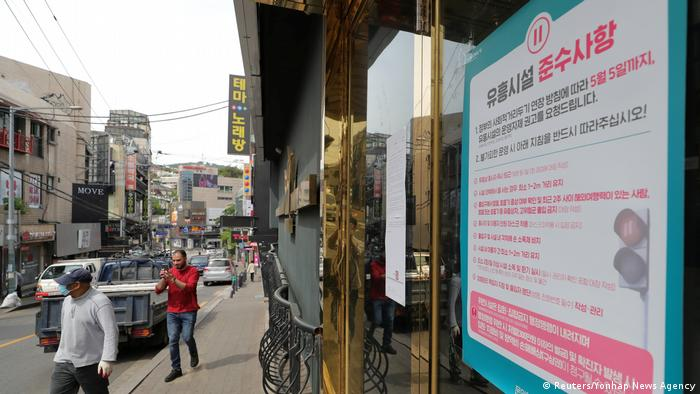 A list of precautions is posted at the entrance of a club in Seoul