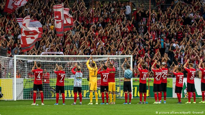 Freiburg players and fans