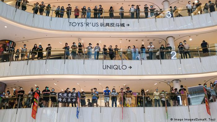 A flash mob anti-government protest in a Hong Kong mall