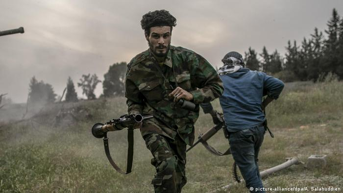 Libyan GNA fighters run for cover