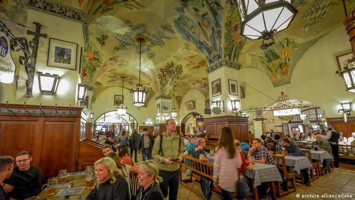 People sitting at tables of Munich's Hofbräuhaus