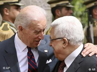 U.S. Vice President Joseph Biden, left, talks with Palestinian President Mahmoud Abbas ahead of their meeting in the West Bank city of Ramallah, Wednesday, March 10, 2010. Israel's new plan to build 1,600 homes for Jews in Palestinian-claimed east Jerusalem overshadowed Vice President Joe Biden's visit to the West Bank on Wednesday. Biden was to hold talks with Palestinian President Mahmoud Abbas and Prime Minister Salam Fayyad, in part to ease their doubts about the latest U.S. peace efforts. (AP Photo/Tara Todras-Whitehill)