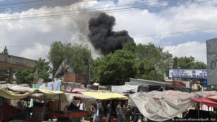Smoke rises from a hospital after an attack on a Kabul hospital