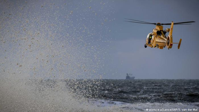 A rescue helicopter is looking for a group of surfers who encountered problems