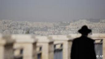 An ultra-Orthodox Jewish man walks in the east Jerusalem neighborhood of Ramat Sholmo