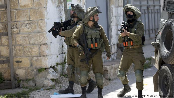Israeli soldiers patrol after a soldier was killed when a rock thrown off a rooftop struck him in the head g during an arrest raid, in the village of Yabad near the West Bank city of Jenin,