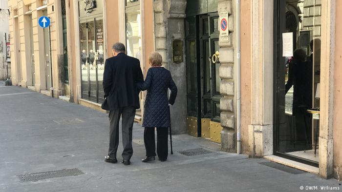 An elderly couple going for a walk in Rome