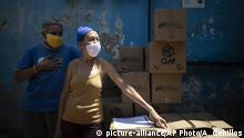 Venezuala Caracas | Coronavirus | Passanten mit Mundschutz