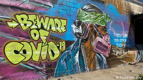 Coronavirus Street Art (Reuters/A. Hay)