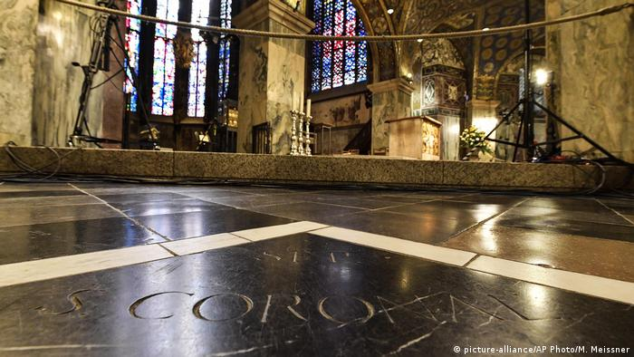 view of floor of Aachen Cathedral, thr words Corona are visible in tghe forefront