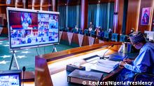 Nigerian President Muhammadu Buhari presides over a cabinet meeting and appoints Ibrahim Gambari as his new chief of staff, in Abuja, Nigeria May 13, 2020. Nigeria Presidency/Handout via REUTERS ATTENTION EDITORS- THIS IMAGE HAS BEEN SUPPLIED BY A THIRD PARTY
