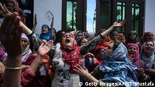 TOPSHOT - Relatives and neighbours mourn the death of Mehrajudin Shah, who according to local media was shot by Indian paramilitary troopers after not stopping at a checkpoint, at his residence in Makhama Beerwah of Kashmir's Budgam district on May 13, 2020. - Hundreds of residents clashed with government forces May 13 in Indian-administered Kashmir after soldiers shot dead a young man at a checkpoint, officials and locals said. His death came amid heightened tensions in the restive Himalayan region after New Delhi scrapped its semi-autonomous status and imposed a curfew to quell unrest. (Photo by Tauseef MUSTAFA / AFP) (Photo by TAUSEEF MUSTAFA/AFP via Getty Images)