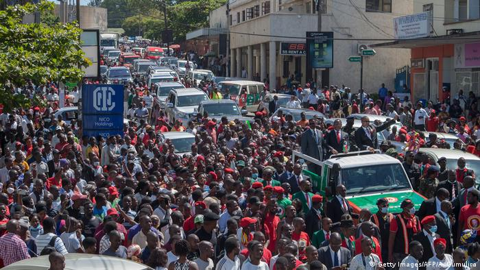 Lazarus Chakwera, the president for Malawis main opposition Party, the Malawi Congress Party (MCP), and his election running mate, Saulos Klaus Chilima, Malawis incumbent Vice President and president for the United Transformation Movement (UTM), leave the Mount Soche Hotel while surrounded by a crowd of supporters in Blantyre.