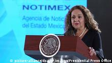 In this handout photo provided by Mexico's Presidential Press Office, Sanjuana Martinez, NOTIMEX director, speaks during the daily press briefing at the National Palace in Mexico City, Friday, July 19, 2019. (Mexico's Presidential Press Office via AP) |