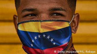 Masked migrant in the colors of the flag of Venezuela
