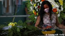 An indigenous woman reacts during the funeral of Chief Messias Kokama, 53, from the Parque das Tribos (Tribes Park), who passed away due to the coronavirus disease (COVID-19), at Parque das Tribos in Manaus, Brazil, May 14, 2020. REUTERS/Bruno Kelly