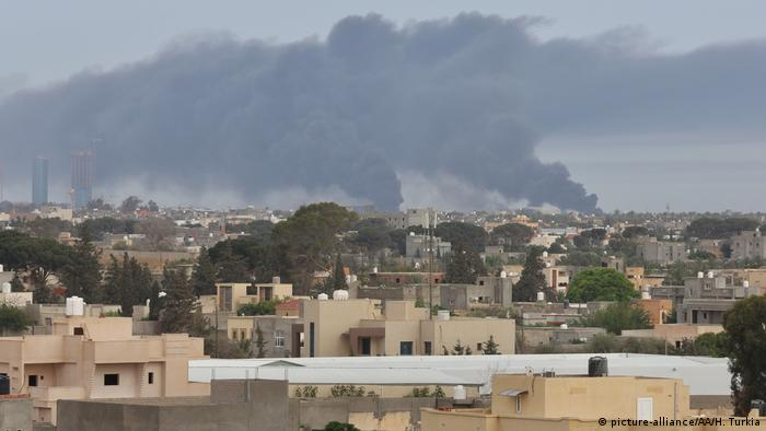 Smoke rises after missile attacks of forces of the warlord Khalifa Haftar targeting Mitiga Airport and its surroundings in Tripoli,