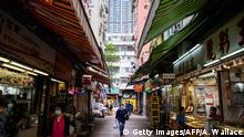 This picture taken on May 14, 2020 shows a general view of new (top) and old residential buildings (centre back), one in which Wong Mei-ying (not pictured), 70, resides in the New Territories of Hong Kong by sharing a bunk bed with her 43-year old son in their 50-square feet cubicle unit in a walk-up flat that has been subdivided into six cubicles. - Squashed inside the 50-square-foot living space she shares with her son, Wong Mei-ying knows social-distancing during the coronavirus pandemic is all but impossible. (Photo by Anthony WALLACE / AFP) (Photo by ANTHONY WALLACE/AFP via Getty Images)