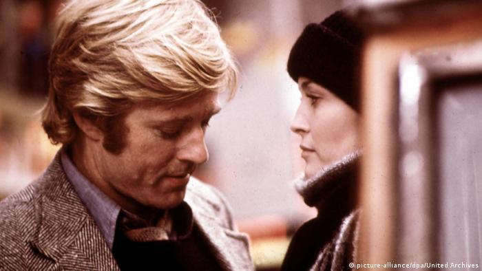 Film still of Robert Redford and Faye Dunaway